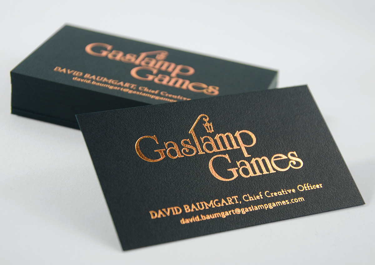 Gaslamp Games: Branding - Copper foil emboss on black stipple business card