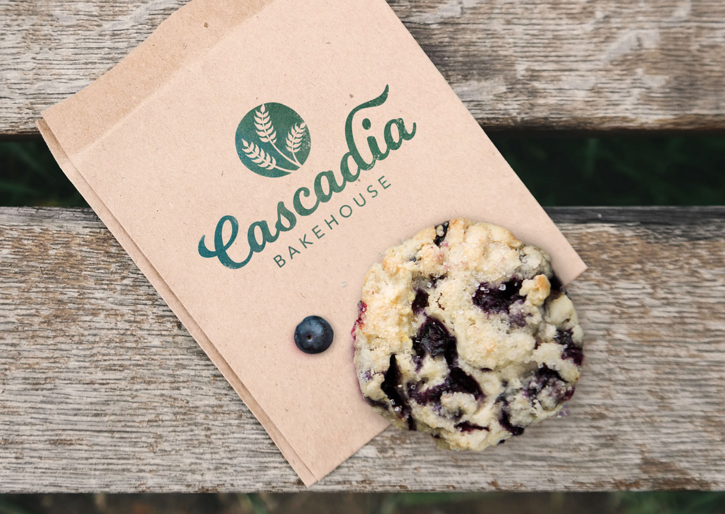 Mockup: Cascadia Bakehouse packaging brown paper bag with stamp